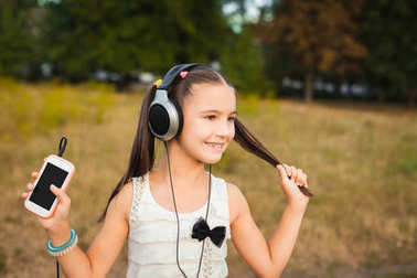 Active girl with long hair listening song