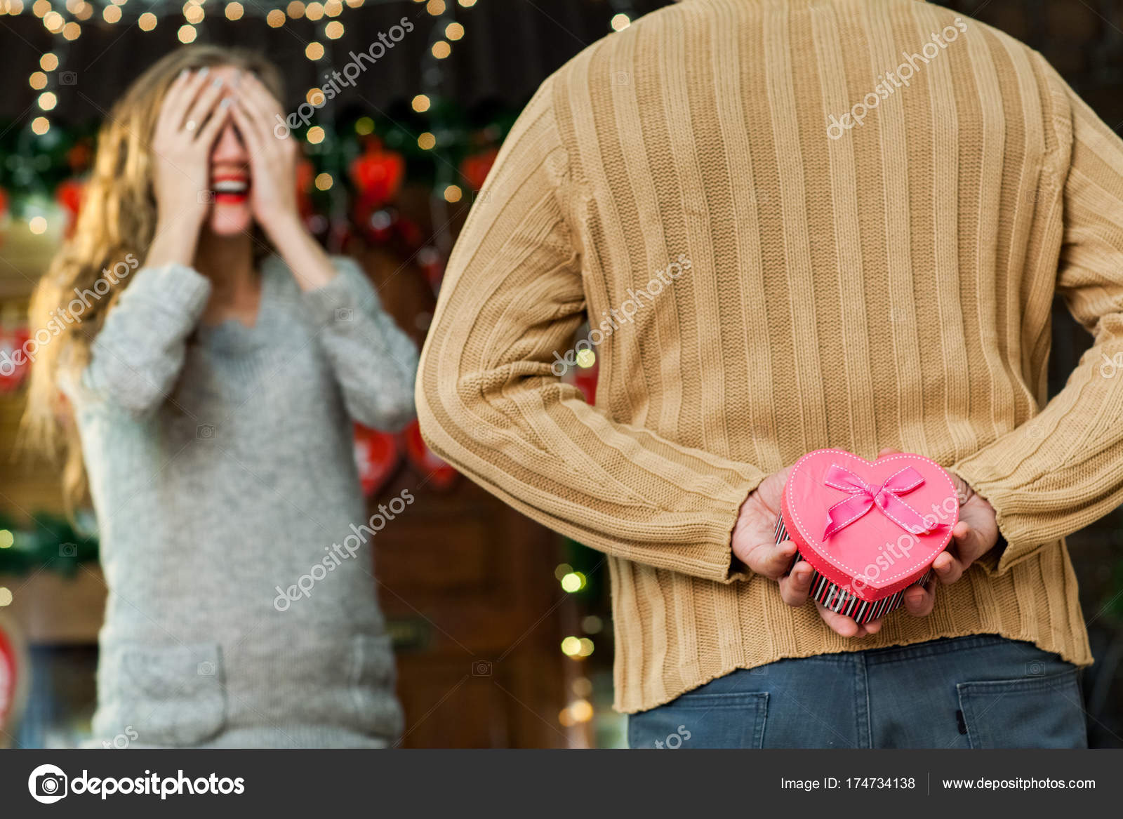 Husband Making Surprise To His Wife On Valentines Day Stock Photo