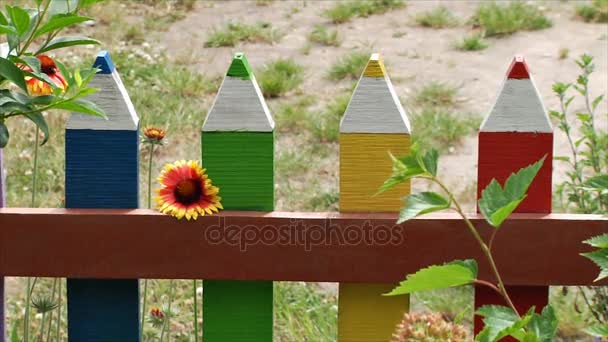 Unusual homemade decorative fence in the form of colored pencils