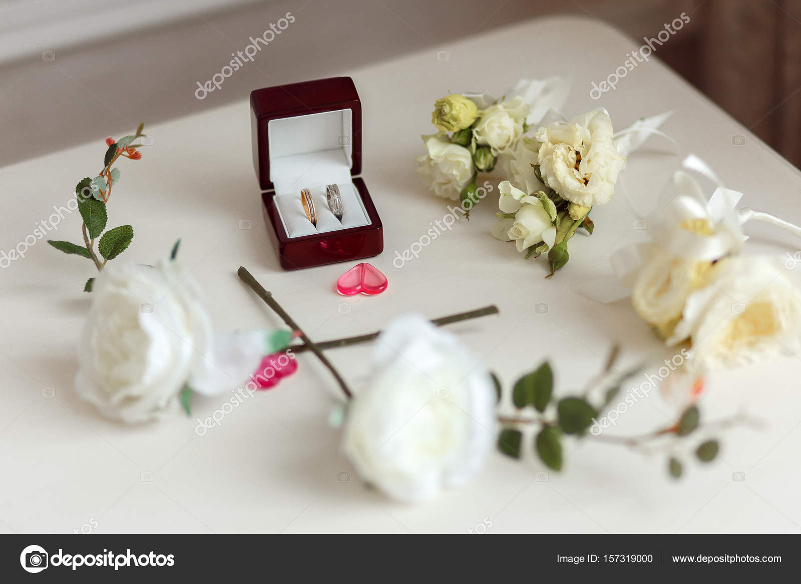 Wedding rings in a beautiful wooden box. Floral arrangement with ...