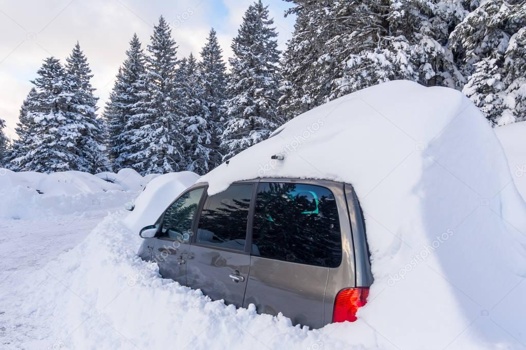 Car buried under the snow