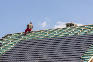 Roofer in work