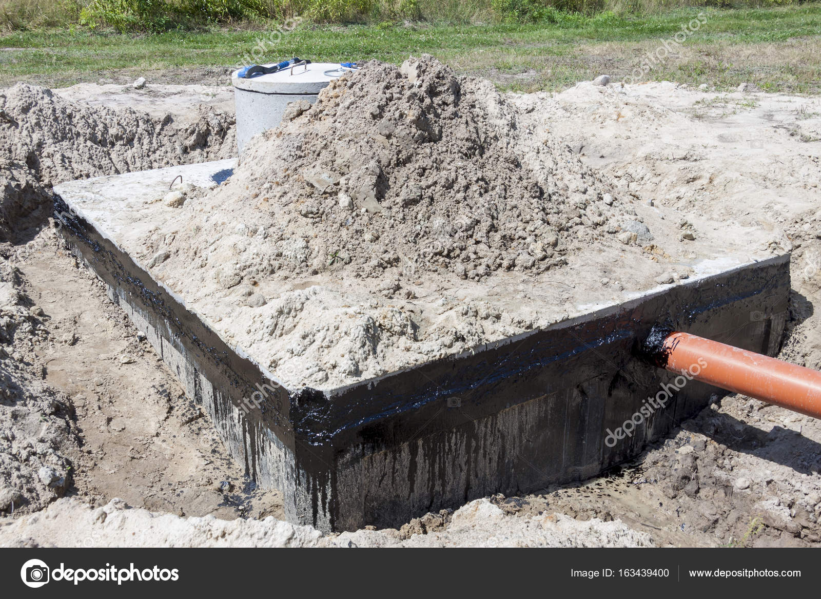 new concrete septic tank construction site photo by tomasz_parys