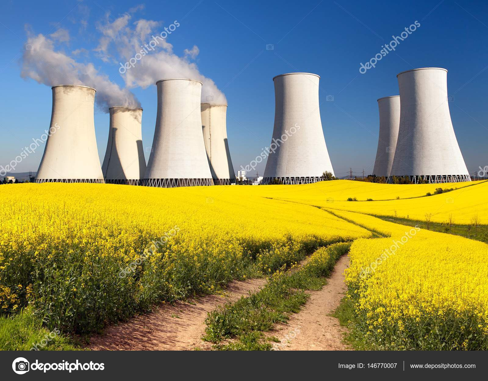 Nuclear power plant cooling tower field of rapeseed — Stock