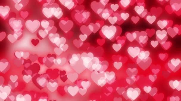 Animované pozadí pro Valentýna. Bokeh srdce. Záznam ze smyčky. Červené pozadí pro milostné výrobky. 4k.