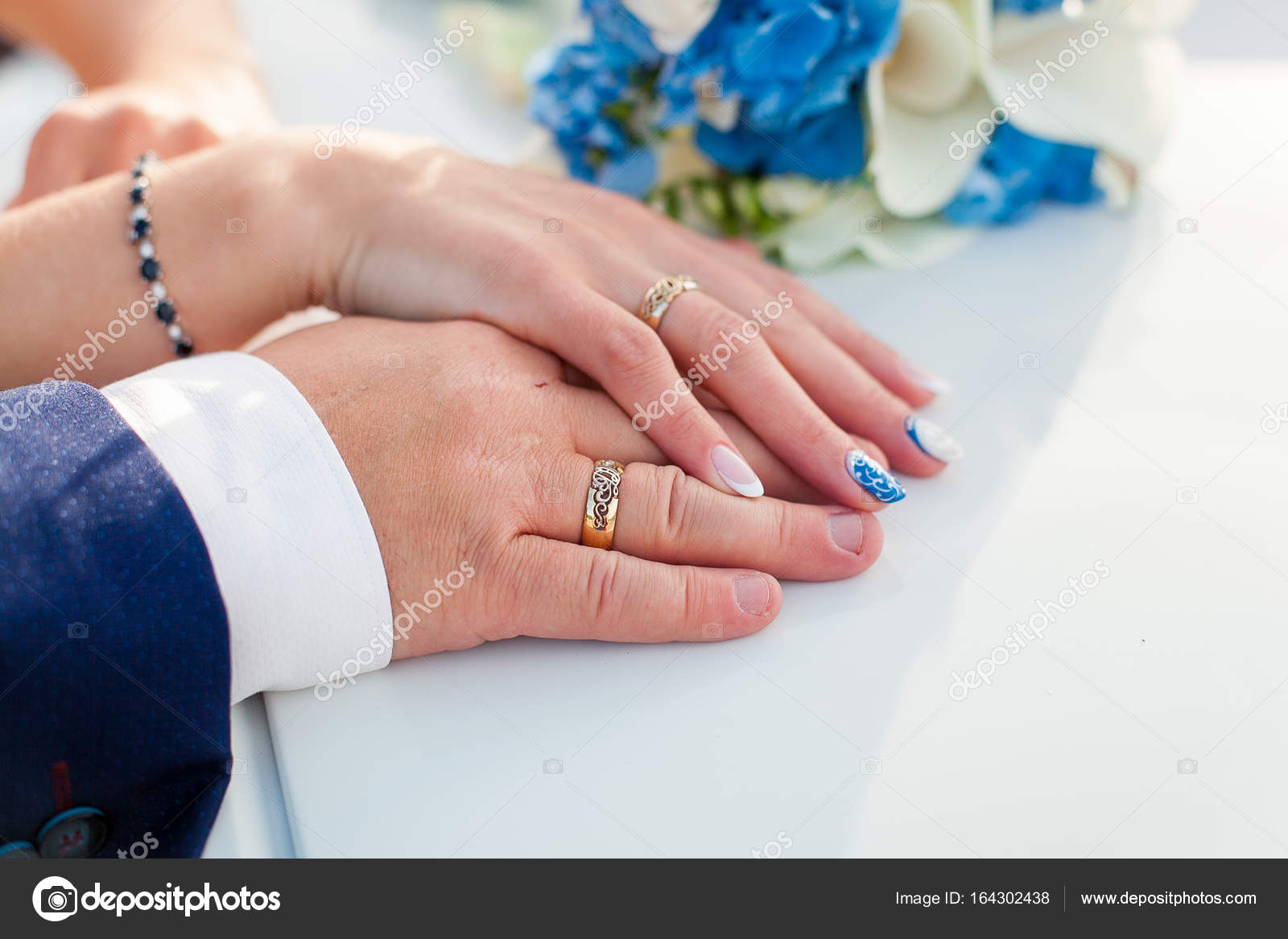 bride and groom holding hands with wedding rings on it — Stock Photo ...