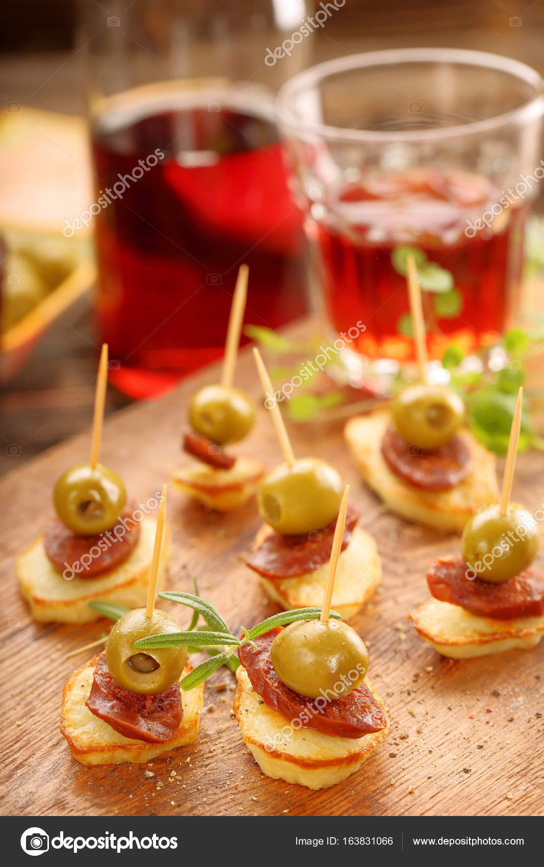 baked potatoes spanish snack with sausage chorizo and green oliv