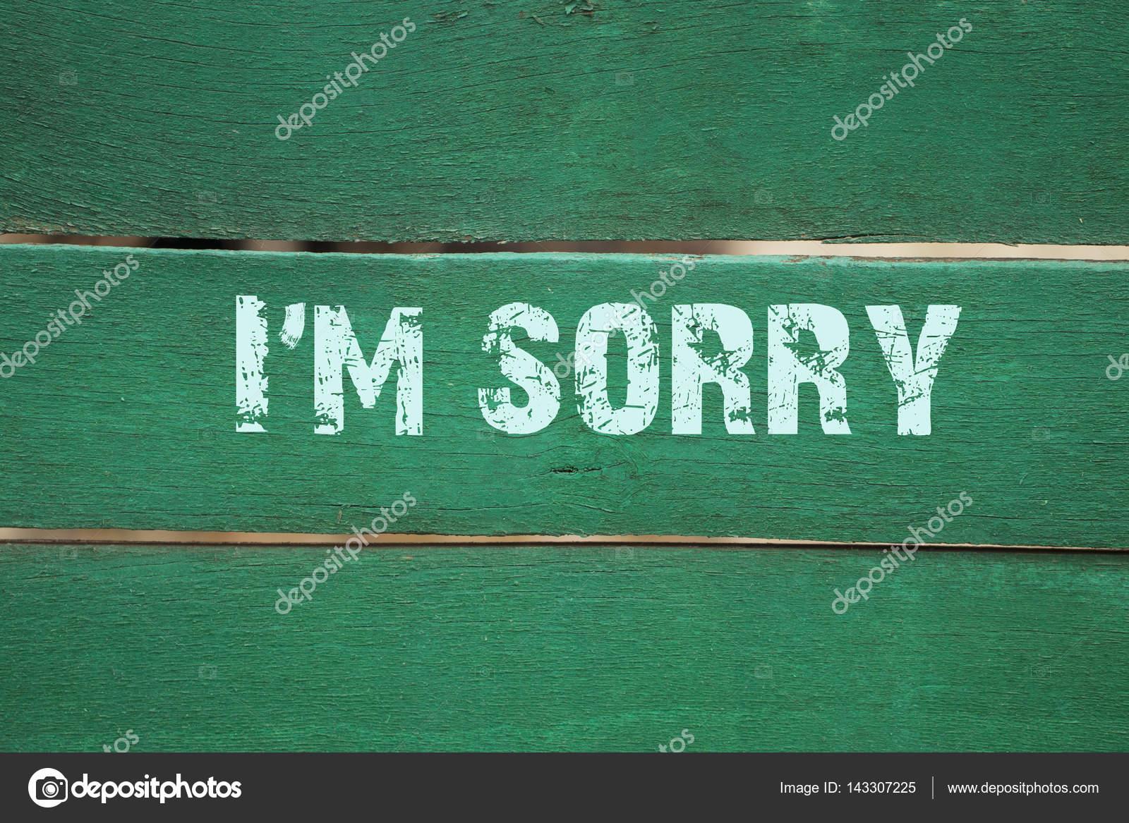 я очень жаль фраза написана на старый зеленый фон стоковое