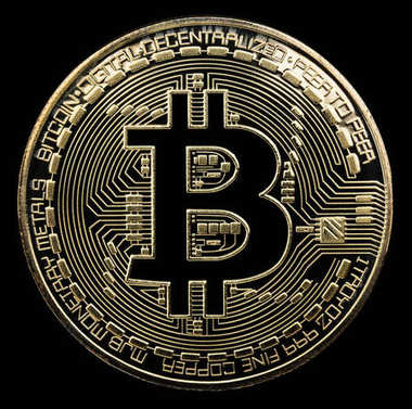 Bitcoin. Physical bit coin. Digital currency. Cryptocurrency. Go