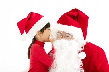 happy Girl telling wish in Santa Claus's ear