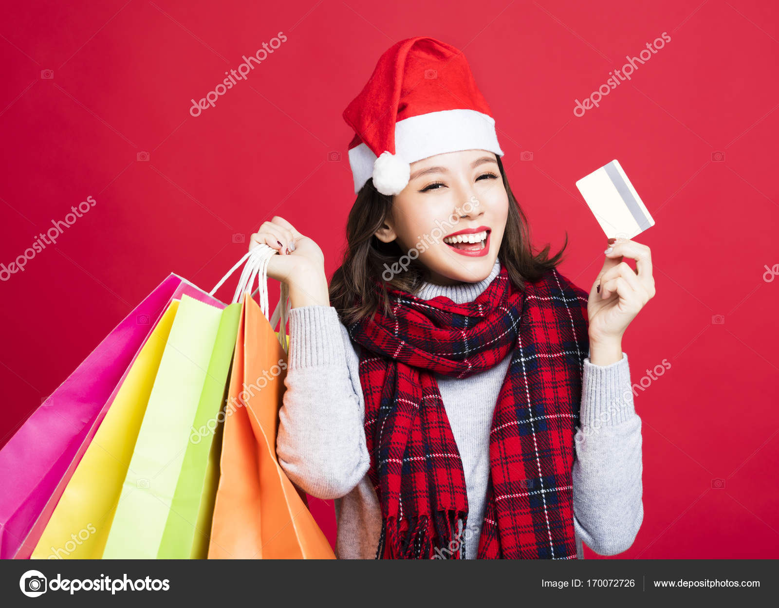 happy Woman shopping for christmas gifts by credit card — Stock ...