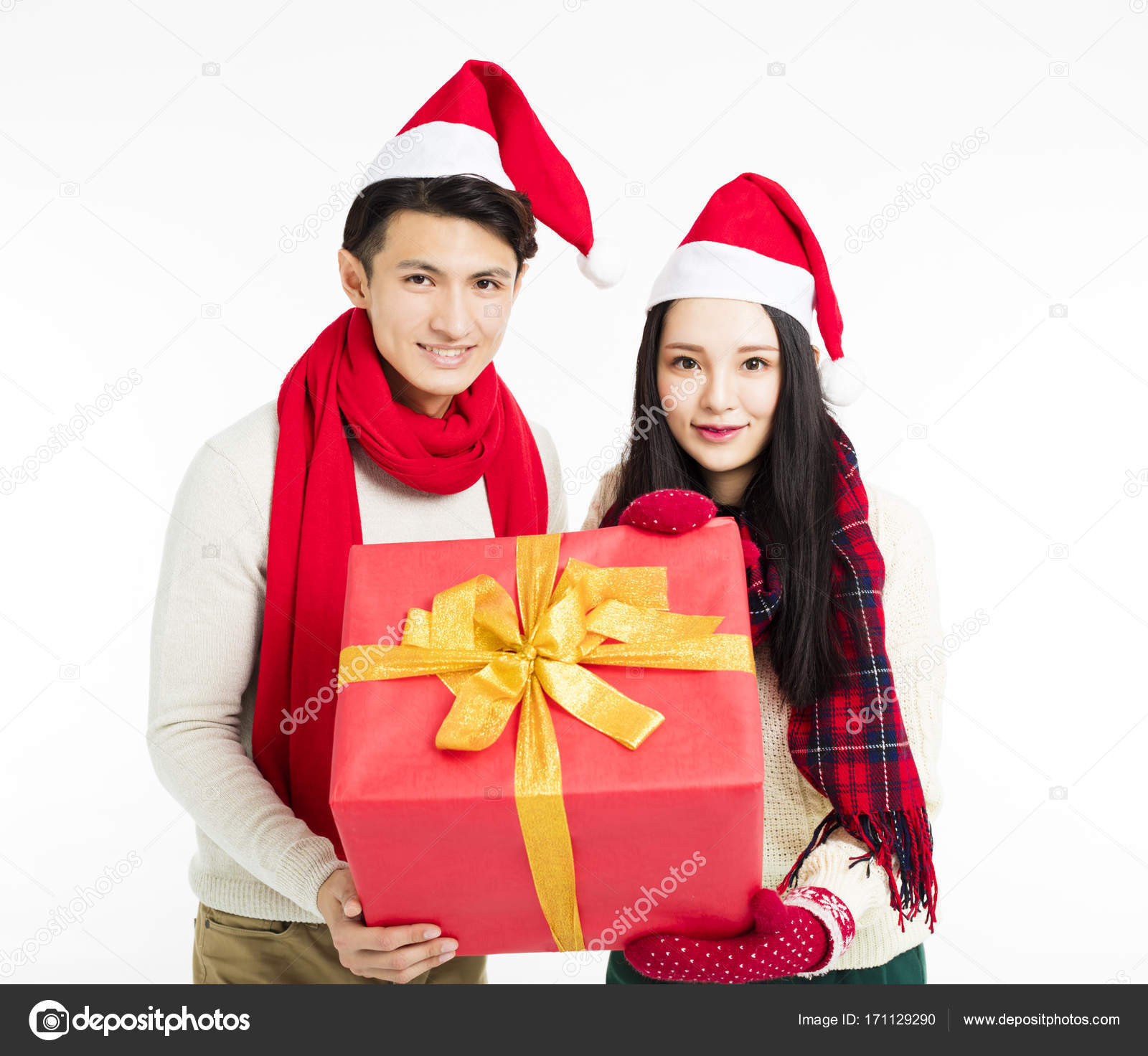happy young couple showing christmas gifts stock photo