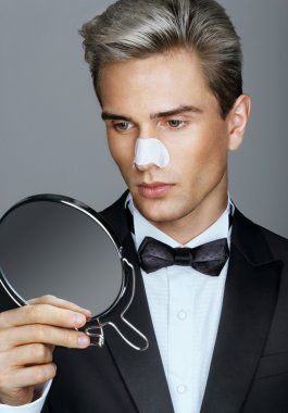 Man with cleaning strips for nose on his face