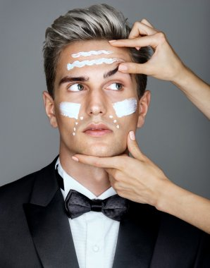 Lifting effects of cream lotion or treatment on man.