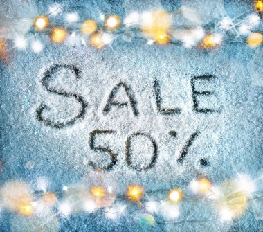 Sale 50 percent off on snow background. Merry Christmas and Happy New Year discount!!