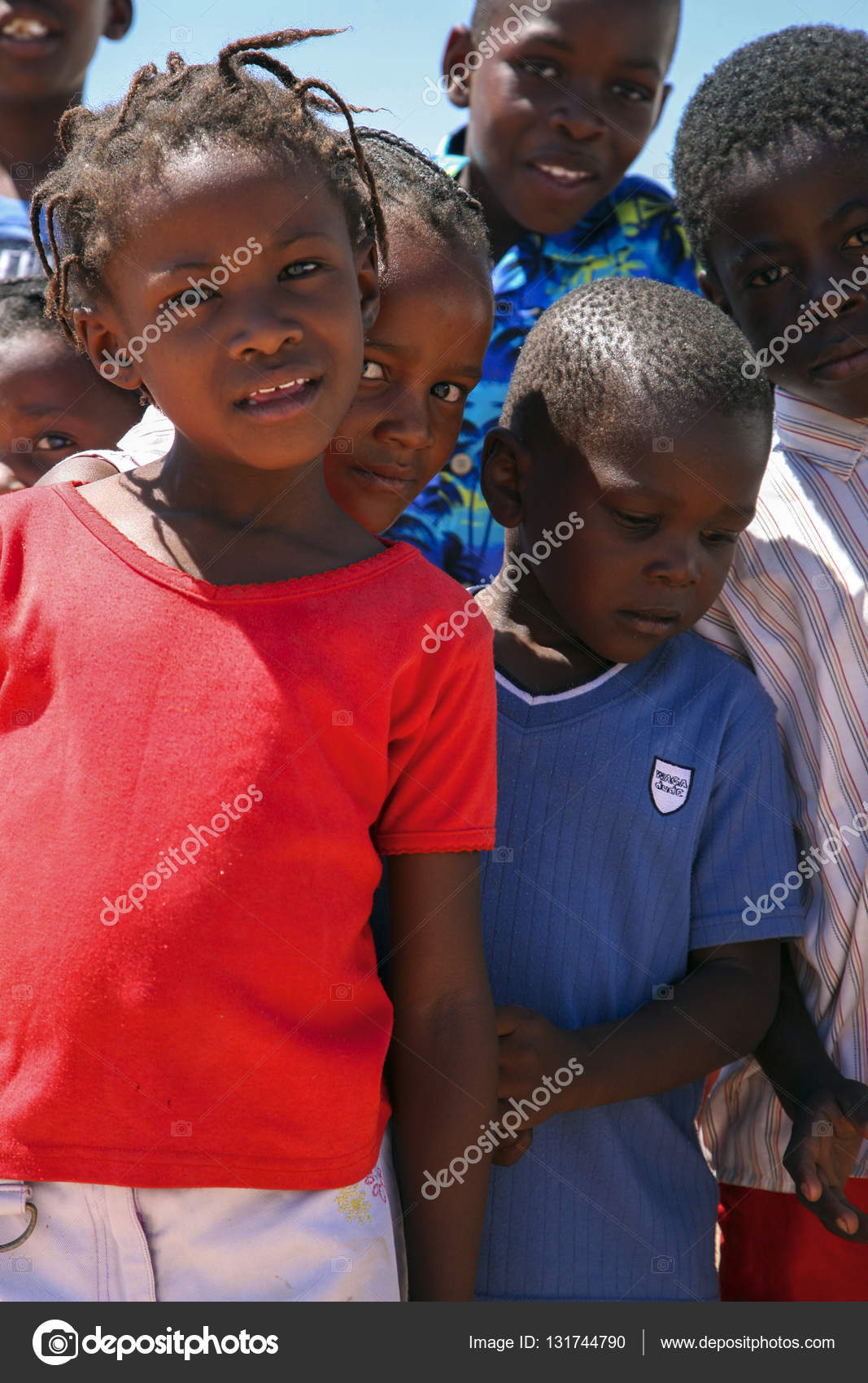 Group of black african kids smiling to the camera namibia stock photo