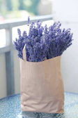 lavender flowers in paper bag
