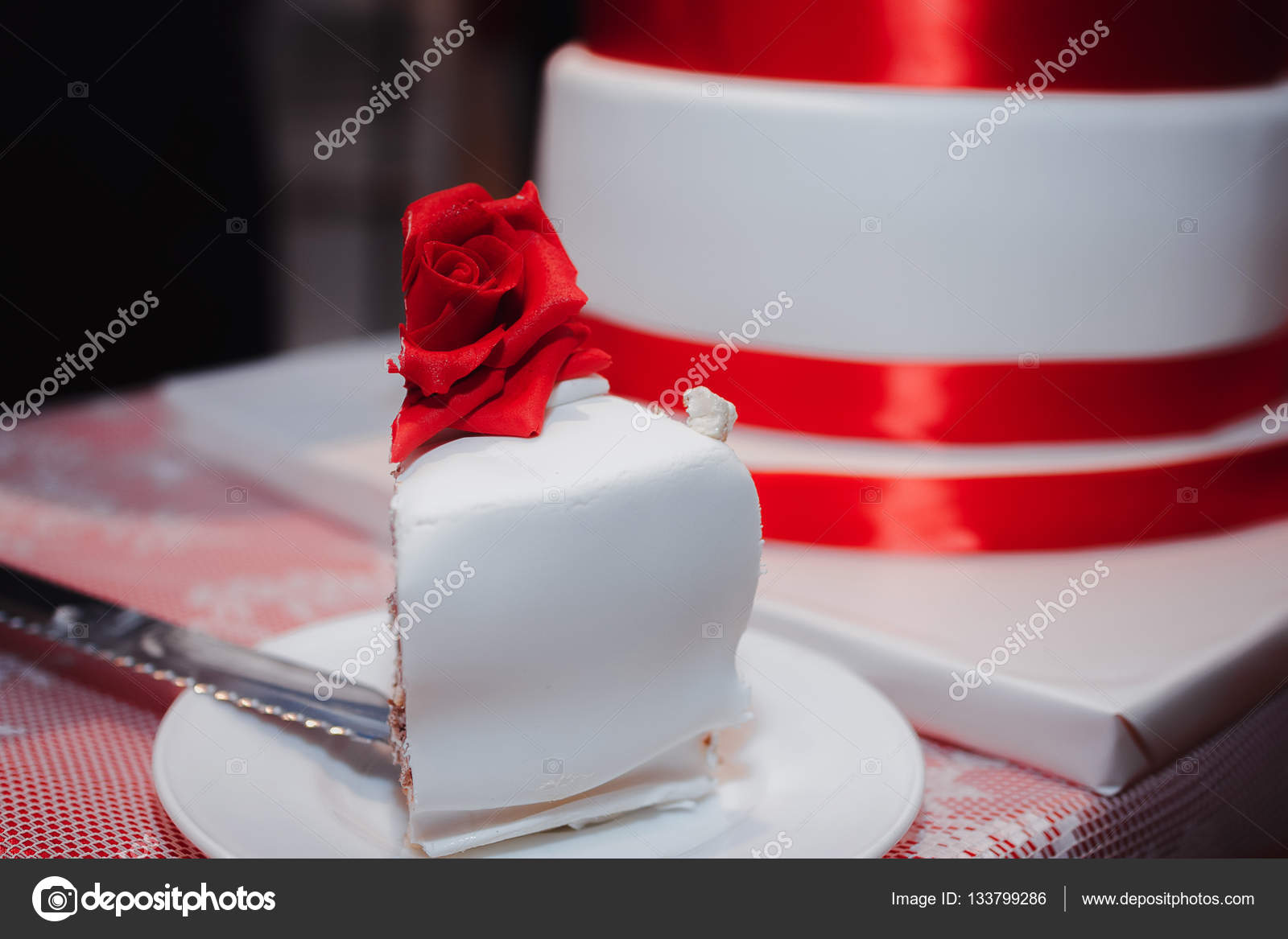 Gorgeous white cake decorated with red flowers roses ribbons and gorgeous white cake decorated with red flowers roses ribbons and bow stock photo mightylinksfo