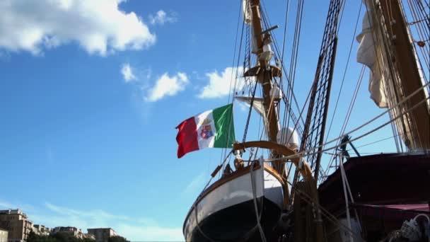 Italian Nautical flag with emblem of four Maritime Republics, Venice, Genoa, Pisa and Amalfi flag flutters in the wind.