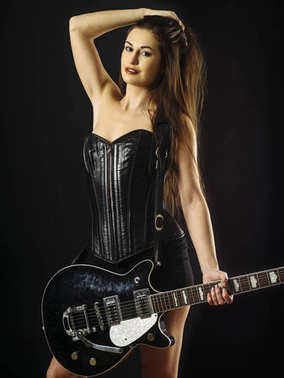Sexy woman with electric guitar