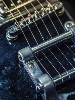 Strings and bridge of an old electric guitar