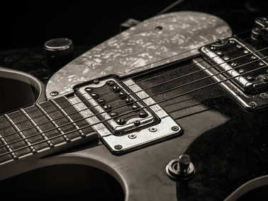 Pickups and strings of old electric guitar