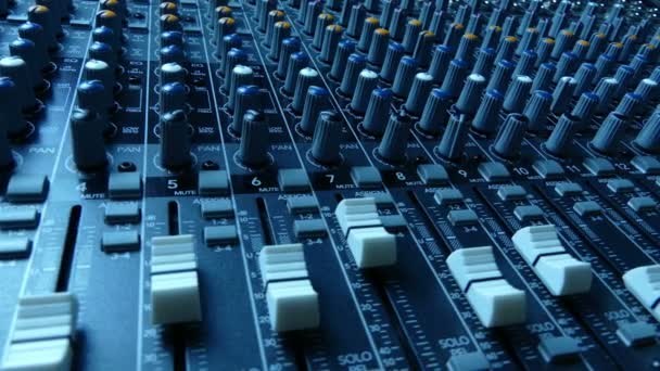 Slide along audio mixing console. Audio mixer buttons and knobs. Vintage sepia look. Music production and sound engineering background