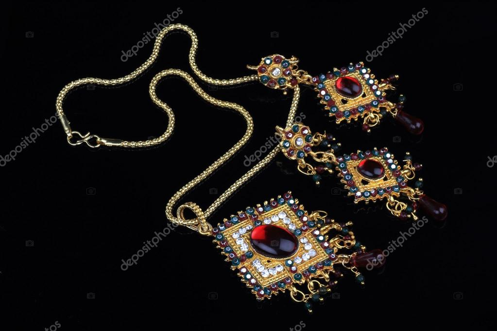 Intricate Indian Gold Jewelry On Black Background — Stock Photo ...