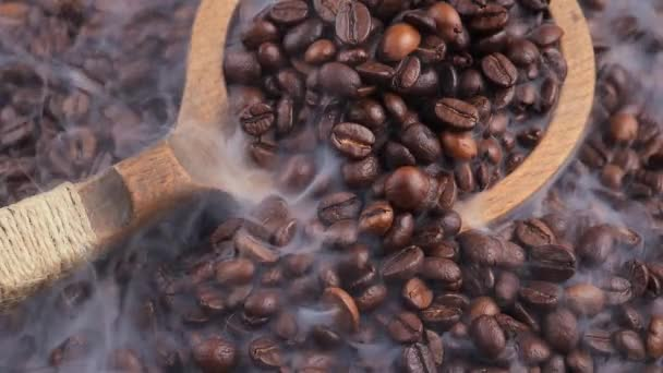 Roasted coffee beans with smoke in a pan