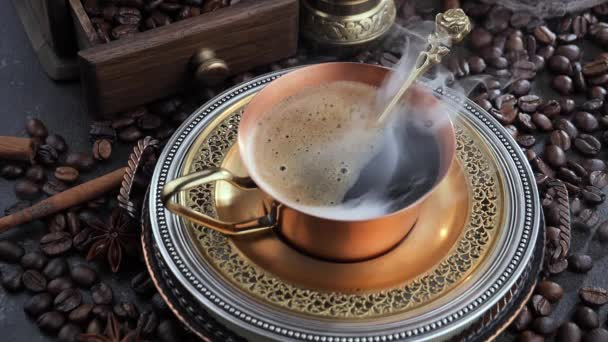 Hot coffee in a cup with steam on an old background.