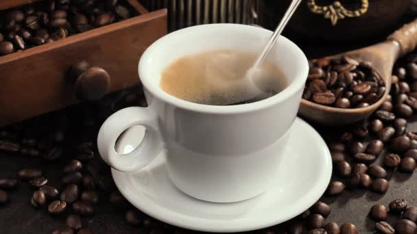Hot coffee in a cup with steam on an old background