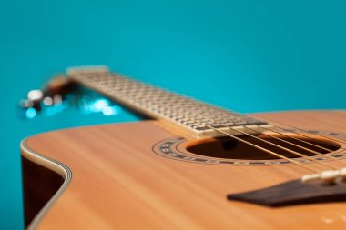Acoustic guitar with blue light