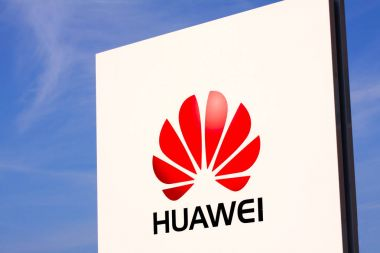 Huawei logotype on white panel sign by headquarters