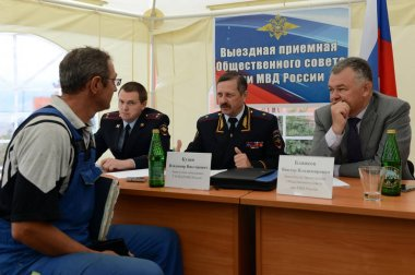 The police major general Vladimir Kuzin and the rector of legal university Victor Blazheev conduct reception of drivers in an exit reception of public council.