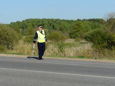 The inspector of traffic police on the road.