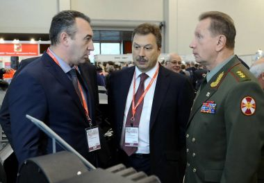 Deputy Ministers of the Interior of Russia Sergey Gerasimov and Viktor Zolotov at the international exhibition