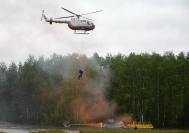 Evacuation with the help of a helicopter BO-105 Centrospas EMERCOM of Russia on the range of the Noginsk rescue center of the Ministry of Emergency Situations.