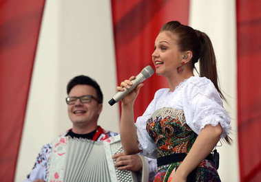 The singer Marina Devyatova performs at a free concert in honor of the Victory Day.