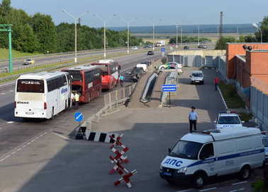 Checking intercity passenger bus at the stationary post road police patrol.
