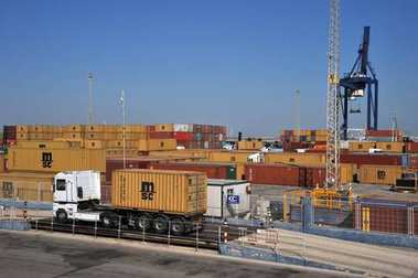 CADIZ, SPAIN - JULY 5, 2011:Weighing the car on the container yard in the seaport of Cadiz.