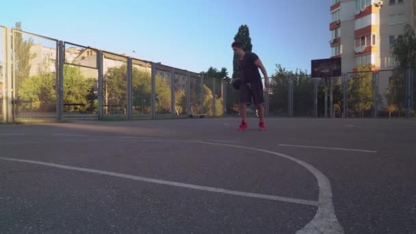 caucasian sportsman playing street ball