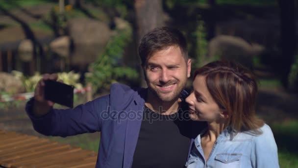 Lovers take selfie photo use smartphone.