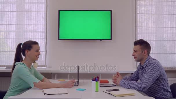 Partners talking in start up