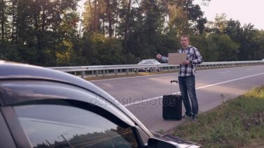 Traveller get town hitch-hiking