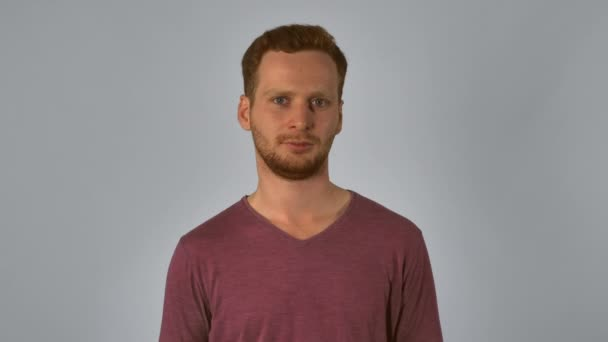 redheaded male shows sign stop