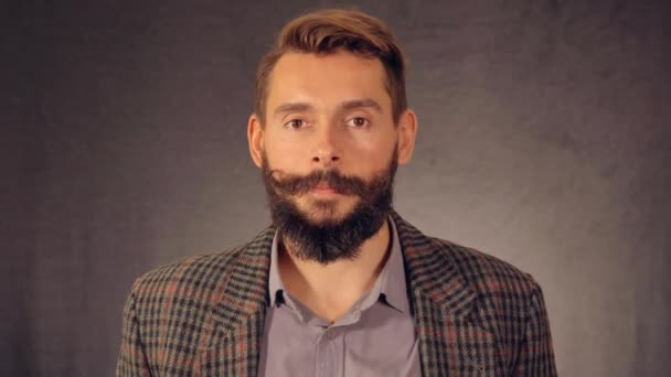 bearded hipster shows sign approval