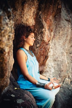 woman meditation on rock