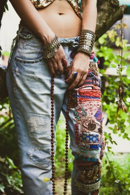 woman in embroidered jeans