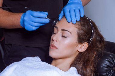 woman face treatment at spa center