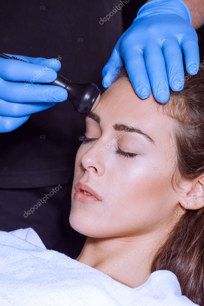 woman face treatment at medical  center